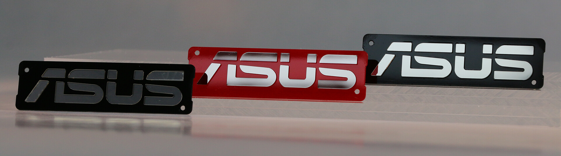 Three Asus Laptop Logos